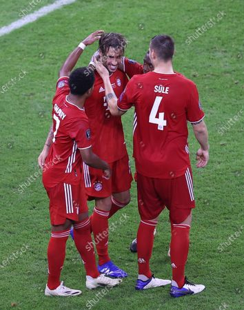 Javi Martinez (C) of Bayern Munich celebrates with teammates after scoring the 2-1 lead during the UEFA Super Cup final between Bayern Munich and Sevilla FC at the Puskas Arena in Budapest, Hungary, 24 September 2020.