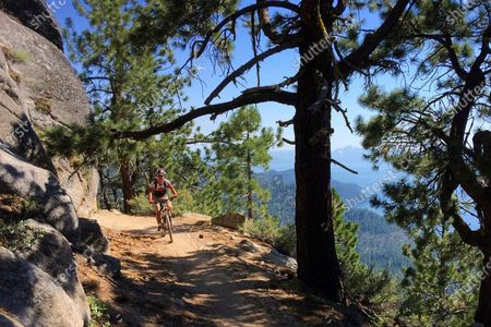 Bicyclist rides down the Flume Trail near Incline Village, Nev., on July 22, 2017. Carson City sheriff's deputies are investigating the discovery of a human skull along a popular mountain biking trail at Lake Tahoe. The sheriff's office says bicyclists at Lake Tahoe State Park found the skull, on the Flume Trail just north of Marlette Lake