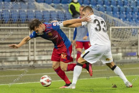 Basel's Valentin Stocker (L) fights for the ball against Anorthosis' Yevhen Selin (R) during the UEFA Europa League third qualifying round soccer match between FC Basel 1893 and Anorthosis Famagusta FC at the St. Jakob-Park stadium in Basel, Switzerland, 24 September 2020.