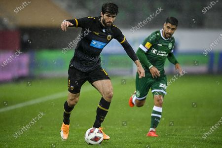 AEK's Karim Ansarifard (L) and St. Gallens Victor Ruiz Abril in action during the UEFA Europa League third qualifying round soccer match between FC St. Gallen and AEK Athens in St. Gallen, Switzerland, 24 September 2020.
