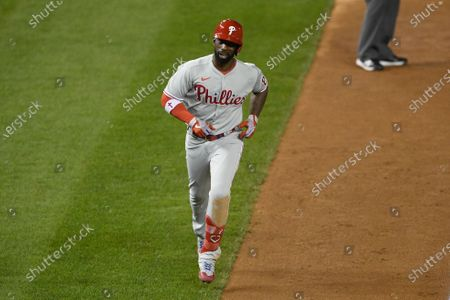Philadelphia Phillies' Andrew McCutchen heads home on his home run during a baseball game against the Washington Nationals, in Washington