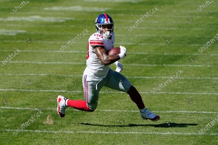 New York Giants tight end Evan Engram (88) runs after a catch against the Chicago Bears during the second half of an NFL football game in Chicago. The 2017 first-round draft pick had shown flashes in his first three seasons, only to be slowed by injuries, again and againstockképe