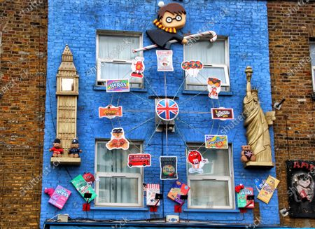 Stock Picture of Harry Potter, Big Ben and the Statue of Liberty are featured on this piece above a sweet store in the High Street. A huge variety of Street Art of all kinds can be found almost around every corner in one of London's artistic and cultural hotbeds of Camden Town.