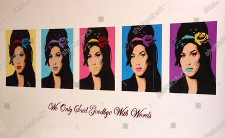Stock Photo of This compilation of images of singer Amy Winehouse, a Camden resident who died in 2011 - is seen at the entrance to an indoor market. A huge variety of Street Art of all kinds can be found almost around every corner in one of London's artistic and cultural hotbeds of Camden Town.