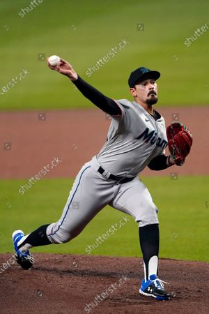Miami Marlins starting pitcher Pablo Lopez (49) delivers in the first Inning of a baseball game against the Atlanta Braves, in Atlanta