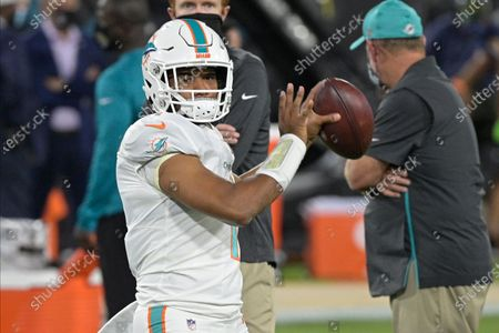 Miami Dolphins quarterback Tua Tagovailoa warms up before an NFL football game against the Miami Dolphins, in Jacksonville, Fla