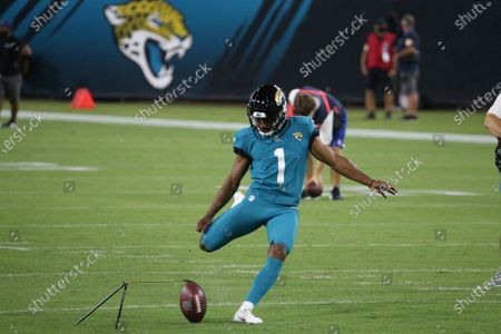 Jacksonville Jaguars kicker Brandon Wright practices kicks before the first half of an NFL football game against the Miami Dolphins, in Jacksonville, Fla