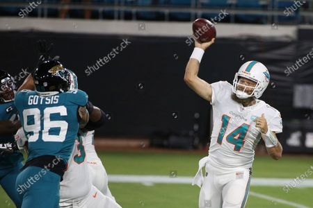Miami Dolphins quarterback Ryan Fitzpatrick (14) throws a pass against the Jacksonville Jaguars during the first half of an NFL football game, in Jacksonville, Fla