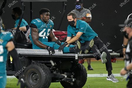 Jacksonville Jaguars outside linebacker Leon Jacobs (48) is taken off the field after he was injured during the first half of an NFL football game against the Miami Dolphins, in Jacksonville, Fla