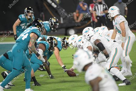 The Jacksonville Jaguars, left, line up for a play against the Miami Dolphins during the first half of an NFL football game, in Jacksonville, Fla