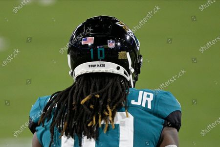 Jacksonville Jaguars wide receiver Laviska Shenault Jr. (10) displays the phrase Stop Hate on his helmet during the first half of an NFL football game against the Miami Dolphins, in Jacksonville, Fla