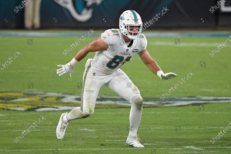 Miami Dolphins tight end Durham Smythe runs a pass pattern during the first half of an NFL football game against the Jacksonville Jaguars, in Jacksonville, Fla