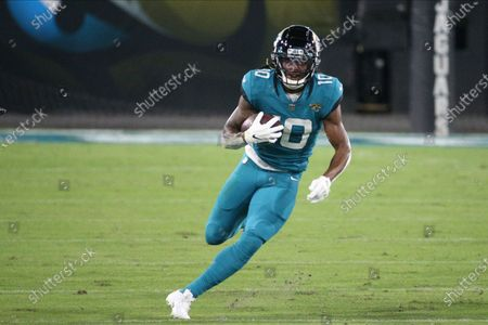 Jacksonville Jaguars wide receiver Laviska Shenault Jr. runs after a reception during the first half of an NFL football game against the Miami Dolphins, in Jacksonville, Fla