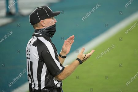 Line Judge Daniel Gallagher rules on the field during the first half of an NFL football game between the Jacksonville Jaguars and the Miami Dolphins, in Jacksonville, Fla