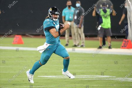 Jacksonville Jaguars quarterback Gardner Minshew scrambles for yardage against the Miami Dolphins during the first half of an NFL football game, in Jacksonville, Fla