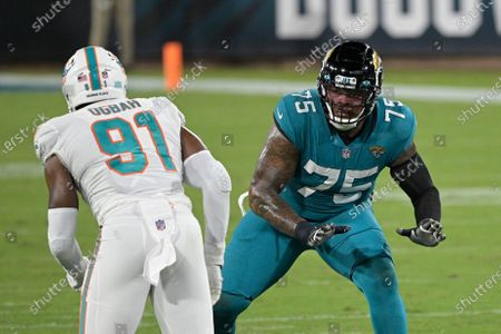 Jacksonville Jaguars offensive tackle Jawaan Taylor (75) looks to block Miami Dolphins defensive end Emmanuel Ogbah (91) during the first half of an NFL football game, in Jacksonville, Fla