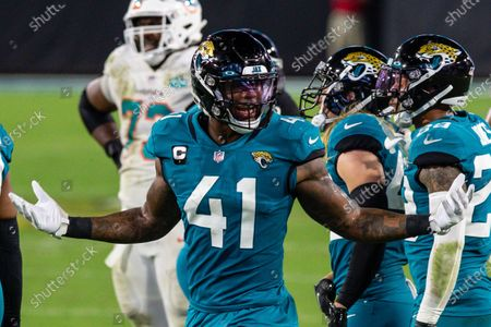 Jacksonville Jaguars defensive end Josh Allen (41) unhappy with a pass interference call on a teammate during the first half of an NFL football game against the Miami Dolphins, in Jacksonville, Fla