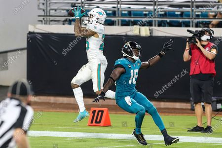 Miami Dolphins cornerback Xavien Howard (25) intercepts a pass thrown to Jacksonville Jaguars wide receiver Chris Conley (18) during the second half of an NFL football game, in Jacksonville, Fla. Dolphins won 31-13