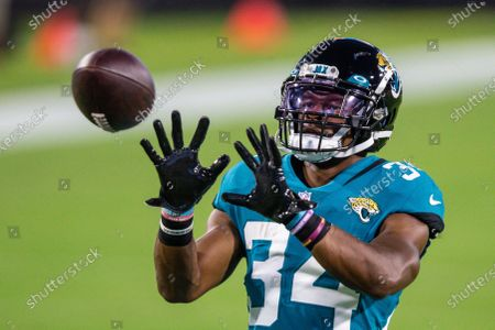 Jacksonville Jaguars running back Chris Thompson (34) during warm ups before an NFL football game against the Miami Dolphins, in Jacksonville, Fla