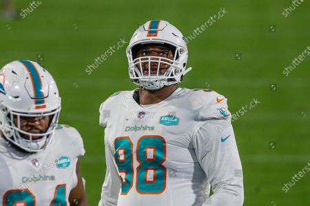 Miami Dolphins defensive tackle Raekwon Davis (98) during warm ups before an NFL football game against the Jacksonville Jaguars, in Jacksonville, Fla