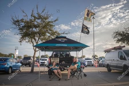 Brain Camp and Taylor Robers tailgate outside TIAA Bank stadium before an NFL football game between the Jacksonville Jaguars and the Miami Dolphins, in Jacksonville, Fla