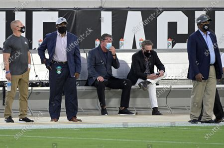 Miami Dolphins special advisor Dan Marino, center, watches warmups before an NFL football game against the Jacksonville Jaguars, in Jacksonville, Fla