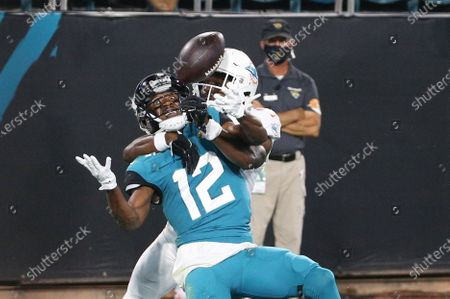 Miami Dolphins cornerback Tae Hayes, right, is called for pass interference as he breaks up a pass intended for Jacksonville Jaguars wide receiver Dede Westbrook during the second half of an NFL football game, in Jacksonville, Fla