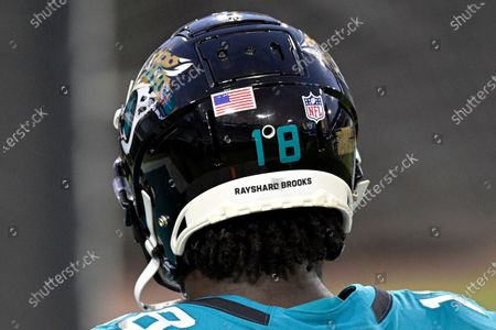 Stock Picture of The helmet of Jacksonville Jaguars wide receiver Chris Conley has the name Rashard Brooks on the back of his helmet to bring attention to social justice as he walks on the field before an NFL football game, in Jacksonville, Fla
