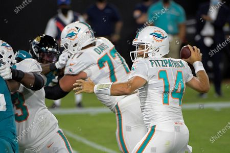 Stock Image of Miami Dolphins quarterback Ryan Fitzpatrick (14) throws a touchdown pass against the Jacksonville Jaguars during the first half of an NFL football game, in Jacksonville, Fla