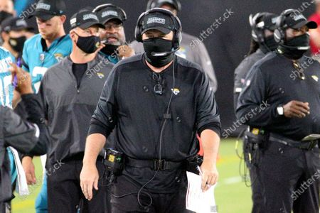 Jacksonville Jaguars head coach Doug Marrone, center, walks the sidelines during the first half of an NFL football game against the Miami Dolphins, in Jacksonville, Fla
