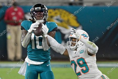 Jacksonville Jaguars wide receiver Laviska Shenault Jr. (10) makes a reception in front of Miami Dolphins free safety Brandon Jones (29) during the first half of an NFL football game, in Jacksonville, Fla