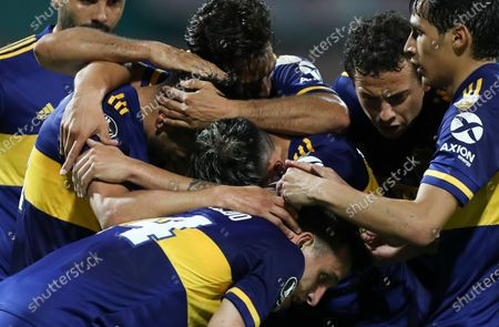 Eduardo Salvio of Argentina's Boca Juniors, left, celebrates with teammates scoring his side's first goal against Colombia's Independiente Medellin during a Copa Libertadores soccer match in Medellin, Colombia