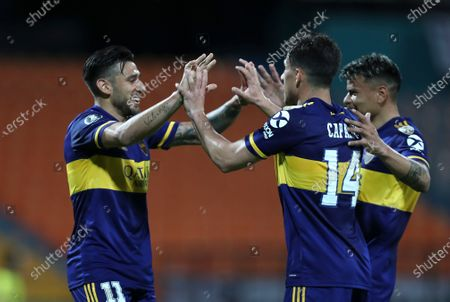Eduardo Salvio of Argentina's Boca Juniors, left, celebrates scoring his side's first goal against Colombia's Independiente Medellin with teammates Walter Bou, right, and Nicolas Capaldo during a Copa Libertadores soccer match in Medellin, Colombia