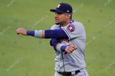 Houston Astros first baseman Yuli Gurriel stretches before the team's baseball game against the Texas Rangers in Arlington, Texas