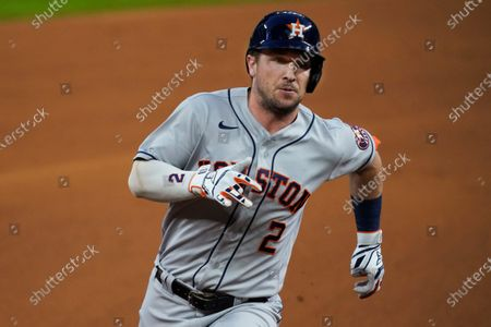 Houston Astros' Alex Bregman heads to third with a triple during the first inning of the team's baseball game against the Texas Rangers in Arlington, Texas