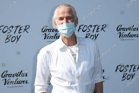 """Matthew Modine arrives at the premiere of """"Foster Boy"""" wearing a face mask, at the Sony Pictures Drive-In Experience in Culver City, Calif"""