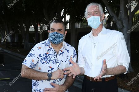 """Director Youssef Delara, left, and Mathew Modine both wearing a face mask attend the premiere of """"Foster Boy"""", at the Sony Pictures Drive-In Experience in Culver City, Calif"""