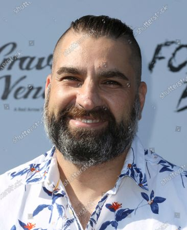 """Director Youssef Delara arrives at the premiere of """"Foster Boy"""", at the Sony Pictures Drive-In Experience in Culver City, Calif"""