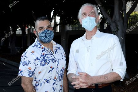 """Director Youssef Delara, left, and Mathew Modine both wearing a face mask arrive at the premiere of """"Foster Boy"""", at the Sony Pictures Drive-In Experience in Culver City, Calif"""