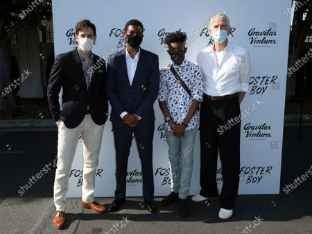 """Belfi Jordan, from left, Shane Paul McGhie, Krystian Alexander Lyttle and Matthew Modine all members of the cast arrive at the premiere of """"Foster Boy"""" wearing face masks, at the Sony Pictures Drive-In Experience in Culver City, Calif"""