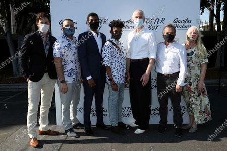 "Jordan Belfi, from left, Youssef Delara, Shane Paul McGhie, Krystian Alexander Lyttle, Matthew Modine, Andrew Sugerman and Anne-Marie Mackay attend at the premiere of ""Foster Boy"", at the Sony Pictures Drive-In Experience in Culver City, Calif"