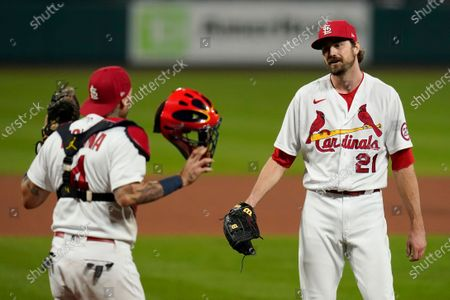 St. Louis Cardinals relief pitcher Andrew Miller (21) and catcher Yadier Molina celebrate a 4-2 victory over the Milwaukee Brewers in a baseball game, in St. Louis