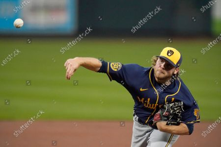 Milwaukee Brewers starting pitcher Corbin Burnes throws during the first inning of a baseball game against the St. Louis Cardinals, in St. Louis