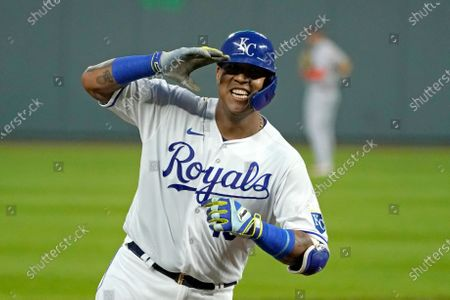 Stock Photo of Kansas City Royals' Salvador Perez celebrates as he runs the bases after hitting a three-run home run during the first inning of the team's baseball game against the Detroit Tigers, in Kansas City, Mo