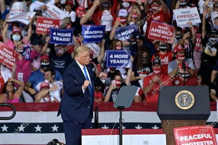 President Donald Trump dances on stage after his campaign rally, in Jacksonville, Fla