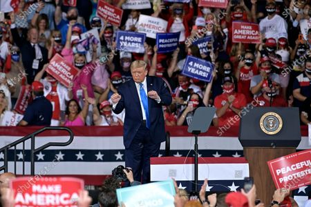 Stock Image of President Donald Trump dances on stage after his campaign rally, in Jacksonville, Fla