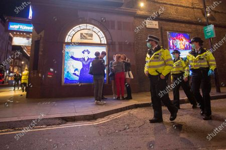 Police officers patrol the streets of Soho in central London on the first day of the 10PM curfew comes into force. Prime Minister Boris Johnson has announced new measures to attempt to reduce the rising number of new Covid-19 infections.