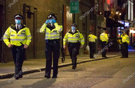 People make their way home from Soho in central London around 10pm on the first day of the 10PM curfew comes into force. Prime Minister Boris Johnson has announced new measures to attempt to reduce the rising number of new Covid-19 infections.