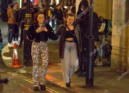 Stock Photo of People make their way home from Soho in central London around 10pm on the first day of the 10PM curfew comes into force. Prime Minister Boris Johnson has announced new measures to attempt to reduce the rising number of new Covid-19 infections.