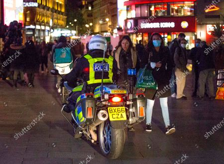 Stock Image of Police officers patrol the streets of Soho in central London on the first day of the 10PM curfew comes into force. Prime Minister Boris Johnson has announced new measures to attempt to reduce the rising number of new Covid-19 infections.